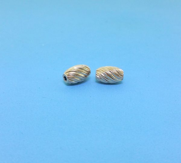 195 - 5x8.5mm Gold Filled Fancy Twisted Bead
